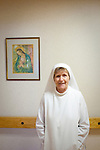 "Sister Mary Kateri, 68, became a nun in 1988. The Catholic nuns run the Our Lady of Perpetual Help Home in Atlanta. The hospital is a place for people with terminal diseases and no money to go. Each nun is assigned a certain number of patients and prays with them and feeds them all day every day. Sister Mary said she cries with the family when her patients die. .She is very jolly, she says, and one of her favorite parts about being a nun is spending time with her sisters ""sharing in spirituality and laughing."" They share a social hour every night and she said sometimes she laughs so much at night that she can't go to sleep."