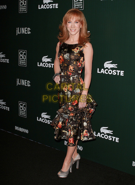 KATHY GRIFFIN.13th Annual Costume Designers Guild Awards held at The Beverly Hilton Hotel, Beverly Hills, California, USA,.22nd February 2011..full length dress black print hand on hip sleeveless floral ruffle hem red clutch bag silver peep toe shoes bracelet .CAP/ADM/KB.©Kevan Brooks/AdMedia/Capital Pictures.