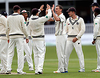 Will Gidman enjoys a high five with team mates after bowling Azhar Ali during day 1 of the four day tour match between Kent CCC and Pakistan at the St Lawrence Ground, Canterbury, on Sat April 28, 2018