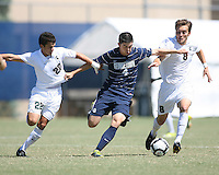 Seth C'deBaca #4 of Georgetown University breaks past Wesley Curtis #22 and Spencer Thompson #8 of Michigan State during an NCAA match at North Kehoe Field, Georgetown University on September 5 2010 in Washington D.C. Georgetown won 4-0.
