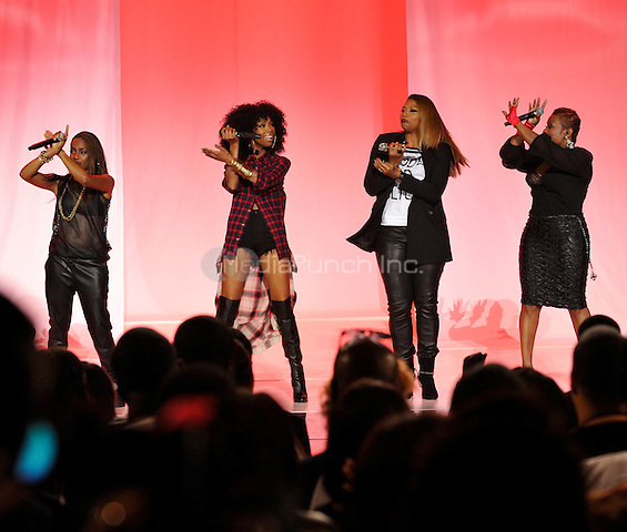 ATLANTA - SEPTEMBER 20: MC Lyte, Brandy, Queen Latifah and Yo-Yo, left to right, perform at the BET Hip Hop Awards 2014 at the Boisfeuillet Jones Atlanta Civic Center on September 20, 2014 in Atlanta, Georgia. Credit: PGTulis/MediaPunch