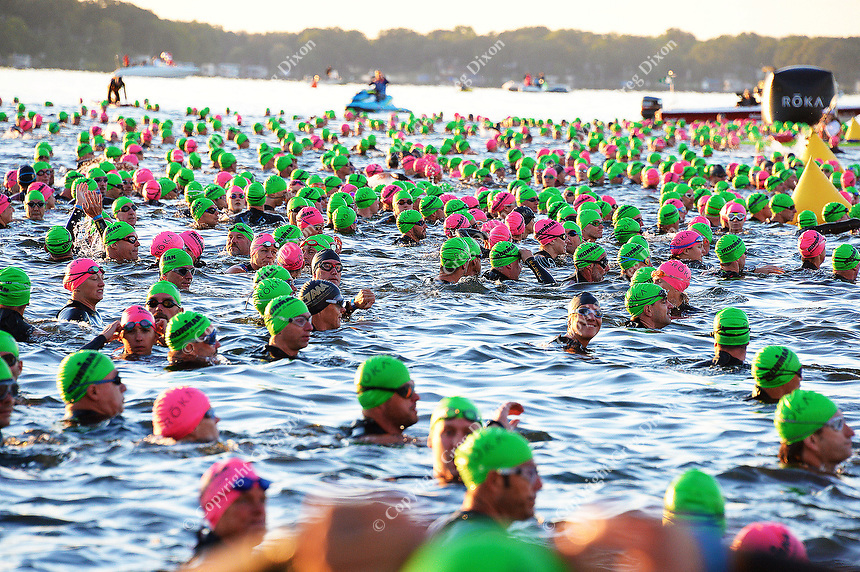 Swimmers gather at the starting line in Lake Monona to begin the 2015 Ironman competition on Sunday, September 13, 2015 in Madison, Wisconsin