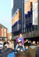 Pictured: A father and his young daughter walk outside Goodison Park stadium. Sunday 16 February 2014<br />