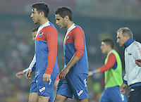 BOGOTÁ-COLOMBIA-16-09-2015. Jugadores de Nacional calientan previo al encuentro de vuelta entre Independiente Santa Fe (COL) y Nacional (UY) por la segunda fase de la Copa Sudamericana 2015 jugado en el estadio Nemesio Camacho El Campín de la ciudad de Bogotá./ Players of Nacional warm up prior the second leg match between Independiente Santa Fe (COL) and Nacional (UY) for the second phase of Copa Sudamericana 2015 played at Nemesio Camacho El Campin stadium in Bogotá city.  Photo: VizzorImage/ Gabriel Aponte /Staff