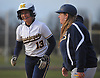 Alexa Kanceler #13, Massapequa right fielder, gets congratulated by first base coach Christina Castellani after her two-run single gave the Chiefs a 4-3 lead in the top of the sixth inning of a Nassau County AA-1 varsity softball game against host East Meadow on Wednesday, April 11, 2018. Massapequa never relinquished the lead afterward and won by a score of 8-4.