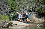 August 20, 2016 - Leadville, Colorado, U.S. -  Ultra distance runners emerge from the willows and negotiate a river crossing prior to ascending to Hope Pass during the Blueprint for Athletes Leadville Trail 100, Leadville, Colorado.  Considered one of the most challenging endurance races in the world, ultra distance runners will navigate high altitude trails, challenging river crossings, and a variety of changing weather with an elevation gain of more than 18,000 feet ranging from 9200 feet near Twin Lakes to 12,600 feet atop the high point of Hope Pass.