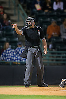 Home plate umpire Jacob Metz makes a strike call during the South Atlantic League game between the Kannapolis Intimidators and the Hickory Crawdads at L.P. Frans Stadium on April 23, 2015 in Hickory, North Carolina.  The Crawdads defeated the Intimidators 3-2 in 10 innings.  (Brian Westerholt/Four Seam Images)