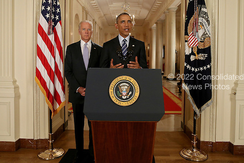 United States President Barack Obama, standing with Vice President Joe Biden, delivers remarks in the East Room of the White House in Washington, Tuesday, July 14, 2015, after an Iran nuclear deal is reached. After 18 days of intense and often fractious negotiation, diplomats Tuesday declared that world powers and Iran had struck a landmark deal to curb Iran's nuclear program in exchange for billions of dollars in relief from international sanctions. <br /> Credit: Andrew Harnik / Pool via CNP