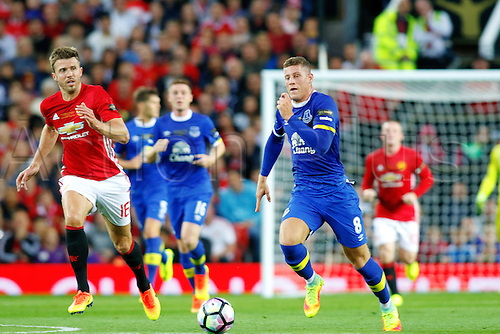 03.08.2016. Old Trafford, Manchester, England. Wayne Rooney Testimonial Football Match. Manchester United versus Everton. Ross Barkley of Everton breaks forward away from Michael Carrick.