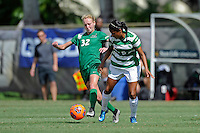 8 November 2015:  Marshall Forward Erin Simmons (32) advances the ball despite the efforts of North Texas Midfield Karla Pineda (9) in the second half as the University of North Texas Mean Green defeated the Marshall University Thundering Herd, 1-0, in the Conference USA championship game at University Park Stadium in Miami, Florida.