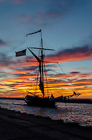 Tall ship returning to port down South Haven's channel after a spectacular sunset.