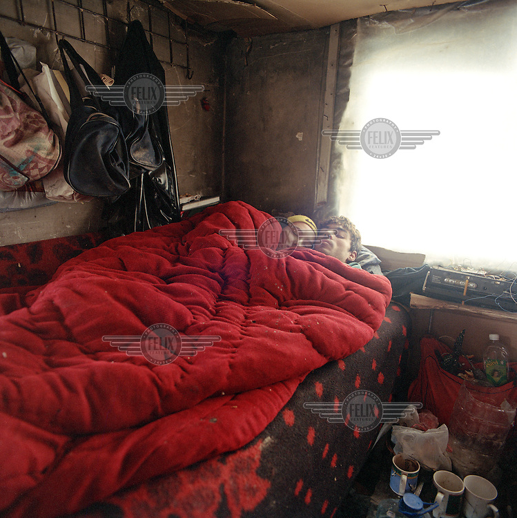 Sorin and Alina in bed. With sheets of plastic serving as windows, the temperature in winter is little different inside to what it is outside - up to 25 degrees celsius below..In Calea Vacaresti, south east of the capital, four families have made their homes in the dried out basin of an artificial lake, constructing shacks from bricks, plastic and assorted rubbish.
