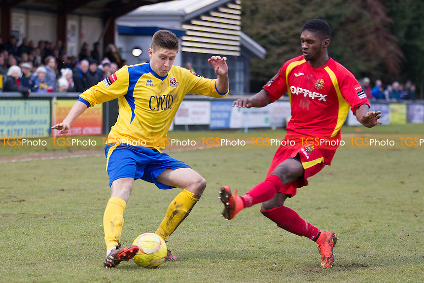 Terry Rymer of AFC Sudbury crosses under pressure from Fabian Simms of Harlow Town - AFC Sudbury vs Harlow Town - Ryman League Division One North Football at the Wardale Williams Stadium, Sudbury, Suffolk - 07/02/15 - MANDATORY CREDIT: Ray Lawrence/TGSPHOTO - Self billing applies where appropriate - contact@tgsphoto.co.uk - NO UNPAID USE