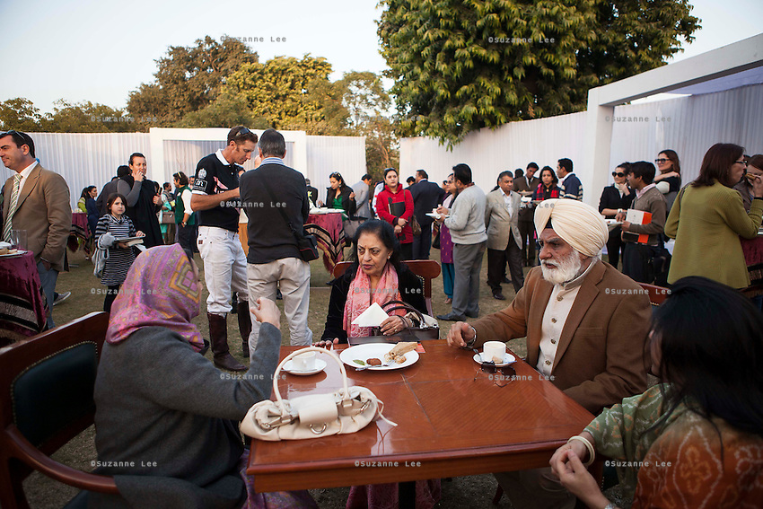 VIP guests and players mingle at the high tea event after the Argyle Pink Diamond Cup, organised as part of the 2013 Oz Fest in the Rajasthan Polo Club grounds in Jaipur, Rajasthan, India on 10th January 2013. Photo by Suzanne Lee