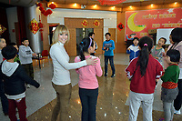 """Swiss singer and TV presenter Francine Jordi play with students while visiting """"SOS Kinderdorf"""" in Tianjin, China. 22-Mar-2016"""
