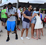 MIAMI BEACH, FL - FEBRUARY 20: Richard Sherman, John Legend and Christine Teigen participates in Sports Illustrated Swimsuit 2014 Beach Volleyball:Models & Celebrity Chefs on February 20, 2014 in Miami Beach, Florida. (Photo by Johnny Louis/jlnphotography.com)