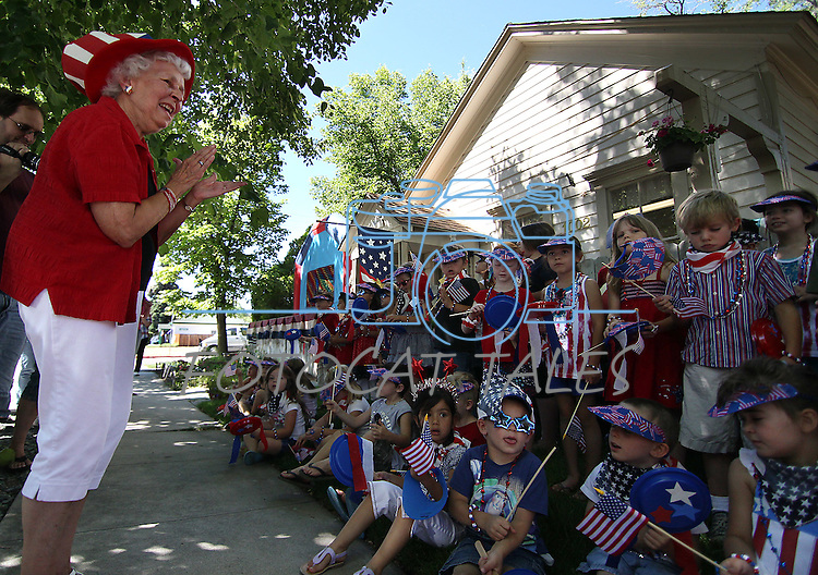 Kinderland Nursery School founder Rosetta McFadden applauds students for their singing, following their annual 4th of July parade in downtown Carson City, Nev., on Friday, July 1, 2011..Photo by Cathleen Allison