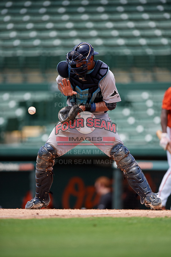 GCL Rays catcher Alexander Alvarez (21) receives a throw during a game against the GCL Orioles on July 21, 2017 at Ed Smith Stadium in Sarasota, Florida.  GCL Orioles defeated the GCL Rays 9-0.  (Mike Janes/Four Seam Images)