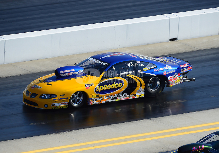 Apr. 14, 2012; Concord, NC, USA: NHRA competition eliminator driver Arnie Martel during qualifying for the Four Wide Nationals at zMax Dragway. Mandatory Credit: Mark J. Rebilas-