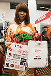 An exhibitor poses for a photograph during the Japan Halal Expo 2015 on November 25, 2015, Chiba, Japan. The Japan Halal Expo 2015 is a trade show which introduces various Japanese Halal products and services held at Makuhari Messe International Convention Complex. About 100 companies and organizations attend this year's two day event aiming to make Japan more friendly to Muslim visitors. This year's main sponsor is YouCoJapan, a website which provides information for Muslim travelers to Japan and business consultation about the Muslim markets. Organizers estimated that approximately 3,280 visitors attended in 2014 and similar numbers are expected this year. In 2013, the Japan National Tourist Organisation reported that the tourists from Muslim-Majority countries including Malaysia and Indonesia increased thanks to visa relaxations, and Japan hopes to continue to attract even more. (Photo by Rodrigo Reyes Marin/AFLO)