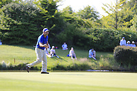 Jose Maria Olazabal (ESP) races to pick up his ball for Mikko Ilonen (FIN) to chip onto the 18th green during Friday's Round 2 of the 2014 Irish Open held at Fota Island Resort, Cork, Ireland. 20th June 2014.<br /> Picture: Eoin Clarke www.golffile.ie