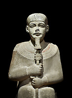 "Ancient Egyptian statue of Ptah - limestone - New Kingdom. 18th Dynasty, reign of Amenhotep III (1390 - 1353 BC), Karnac. Egyptian Museum, Turin.  black background<br /> <br /> Large statue of Egyptian gods are rare and most of them are part of building designs. This imposing statue of Ptah was probably made for the ""Temple of Millions of Years"", on the west bank of Thebes, promoted by Amenhotep III . When the temple was eventually abandoned its statues were reused in other temples in the region. Drovetti collection C. 87"