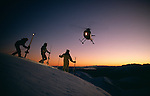 Heliskiers waiting for helicopter at sunset. Mount Hutt. Canterbury. New Zealand.