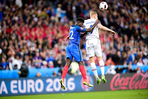 03.07.2016. St Denis, Paris, France. UEFA EURO 2016 quarter final match between France and Iceland at the Stade de France in Saint-Denis, France, 03 July 2016. Samuel Umtiti (France) challenges for the header with Kolbeinn Sigthorsson (Ice)
