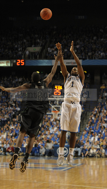 Darius Miller (1) takes a 3 point shot during the first half of the University of Kentucky Basketball game against Loyola at Rupp Arena in Lexington, Ky., on 12/22/11. UK won the game 87-63. Photo by Mike Weaver | Staff