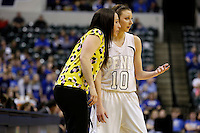 Penn Kaitlyn Marenyi guard (10) talks with head coach Kristi Kaniewski UIrich during the IHSAA Class 4A Girls Basketball State Championship Game on Saturday, Feb. 27, 2016, at Bankers Life Fieldhouse in Indianapolis.