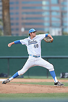 Tucker Forbes (48) of the UCLA Bruins pitches during a game against the Arizona Wildcats at Jackie Robinson Stadium on May 16, 2015 in Los Angeles, California. UCLA defeated Arizona, 6-0. (Larry Goren/Four Seam Images)