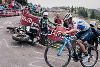 Maglia Bianca / best young rider Richard Carapaz (ECU/Movistar) avoiding a crashed moto up the infamous Monte Zoncolan (1735m/11%/10km)<br /> <br /> stage 14 San Vito al Tagliamento &ndash; Monte Zoncolan (186 km)<br /> 101th Giro d'Italia 2018