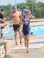 NWA Democrat-Gazette/FLIP PUTTHOFF<br /> SWIM BIKE RUN<br /> Athletes leave the pool after a 200-meter swim to head out on their bicycles for a 4. 7-mile ride during the TriFest for MS triathlon held Saturday at the Melvin Ford Aquatic Center in Bentonville. Two triathlons were held Saturday including a super sprint race that involved the 200-meter swim, 4.7-mile bike and 1-mile run. Triathlon events continue today to raise funds for multiple sclorosis research. TriFest for MS benefits the area Rampy MS Research Foundation, said triathlon volunteer Heather Foitek (cq).