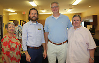 NWA Democrat-Gazette/CARIN SCHOPPMEYER Gail Eads (from left), J.D. Hays, David Pieper and Teddy Cardwell, Peace at Home board chairwoman, welcome guests to the shelter's open house Sept. 6.