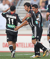U.S. Open Cup Round of 16, Alecko Eskandarian (11) and Facundo Herpen (5) celebrate Jaime Moreno's (99) goal. DC United defeated Columbus Crew in overtime 2-1, Tuesday, August 1, 2006, at Maryland Soccerplex.
