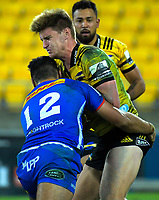 Damian de Allende tackles Jordie Barrett during the Super Rugby match between the Hurricanes and Stormers at Westpac Stadium in Wellington, New Zealand on Saturday, 23 March 2019. Photo: Dave Lintott / lintottphoto.co.nz