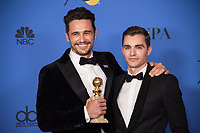 After winning the category of BEST PERFORMANCE BY AN ACTOR IN A MOTION PICTURE &ndash; COMEDY OR MUSICAL for his work in &quot;The Disaster Artist,&quot; actor James Franco poses backstagewith Dave Franco in the press room with his Golden Globe Award at the 75th Annual Golden Globe Awards at the Beverly Hilton in Beverly Hills, CA on Sunday, January 7, 2018.<br /> *Editorial Use Only*<br /> CAP/PLF/HFPA<br /> &copy;HFPA/PLF/Capital Pictures