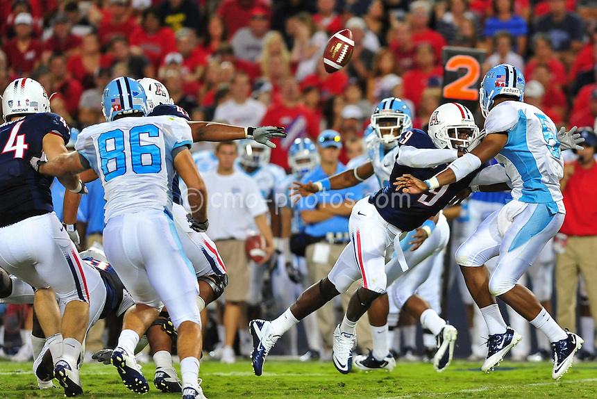 ept 11, 2010; Tucson, AZ, USA; Arizona Wildcats safety Joseph Perkins (9) forces Citadel Bulldogs quarterback Matthew Thompson (5) to pitch the ball on an option play in the 2nd quarter of a game against the Citadel Bulldogs at Arizona Stadium. Arizona won the game 52-6.