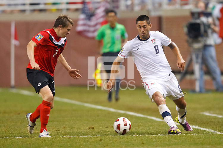 7 June 2011: USA Men's National Team forward Clint Dempsey (8) dribbles the ball at Canada midfielder Terry Dunfield (7) in the second half during the CONCACAF soccer match between Panama and Guadeloupe at Ford Field Detroit, Michigan.