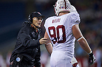SEATTLE, WA - September 28, 2013: Stanford defensive line coach Randy Hart talks with defensive end Josh Mauro during play Washington State at CenturyLink Field. Stanford won 55-17.