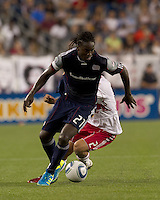 New England Revolution midfielder Shalrie Joseph (21) works to get the ball out of the defensive zone. In a Major League Soccer (MLS) match, the New England Revolution tied New York Red Bulls, 2-2, at Gillette Stadium on August 20, 2011.