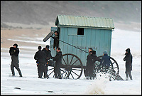 BNPS.co.uk (01202 558833)<br /> Pic: Graham Hunt/BNPS<br /> <br /> The camera crew emerge from the waves...<br /> <br /> The Cruel Sea - Attempts to film Saoirse Ronan emerging from a bathing machine into the freezing and stormy waters off Dorset today proved tricky - At one point a wave completely engulfed the film unit.