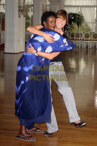 "WARIS DIRIE & SHERRY HORMAN .""Desert Flower"" photocall during the .66th Venice International Film Festival, Hotel Excelsior, Lido, Venice, Italy, .5th September 2009..full length blue and white print dress black top trousers long maxi hugging embracing flip flops grey grey .CAP/RD .©Richard Dean/Capital Pictures"