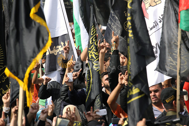 Islamic Jihad movement supporters take part in a rally marking the 26th anniversary of the movement's foundation and marking the 18th anniversary of the death of the group's leader Fathi Shikaki, in Gaza City, Friday, Nov. 1, 2013. Shikaki, the founder of the Islamic Jihad group, was gunned down in Malta by a man on a motorcycle in an attack widely attributed to Israel. Photo by Mohammed Asad
