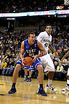 Duke Blue Devils forward Miles Plumlee (21) turns for a shot with Wake Forest Demon Deacons center Ty Walker (40) on defense. Duke wins 83-59..