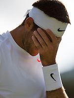 01-07-13, England, London,  AELTC, Wimbledon, Tennis, Wimbledon 2013, Day seven, Juan Martin Del Potro (ARG)<br /> is frustrated<br /> <br /> <br /> <br /> Photo: Henk Koster