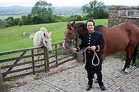 Portrait of Detmar Blow with his horse at his family home in The Cotswolds