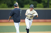 Chris Lanzilli (24) of the Wake Forest Demon Deacons rounds third base after hitting a home run against the Virginia Cavaliers at David F. Couch Ballpark on May 19, 2018 in  Winston-Salem, North Carolina. The Demon Deacons defeated the Cavaliers 18-12. (Brian Westerholt/Four Seam Images)