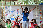 Jazel Resurreccion Lustre, a teacher with the Kapatiran-Kaunlaran Foundation (KKFI), leads children in singing in a KKFI-sponsored preschool in Pulilan, a village in Bulacan, Philippines.<br /> <br /> KKFI is supported by United Methodist Women, which also provided a scholarship for Resurreccion's university studies.
