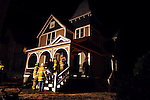 Firefighters in Stafford work at a home while the investigation was underway, Tuesday, Feb. 14, 2012, on Morton Street in Stafford. West Stafford Fire Chief Joseph Lorenzetti praised the effort of firefighters from his department and the Stafford Fire Department Number 1 to contain the fire to a first floor wall at the front of the house. Lorenzetti said the house was vacant at the time of the fire and is under going renovations.  Lorenzetti said the home had balloon construction which allows air into the walls feeding a fire and allowing the fire to travel  up which can lead to a major house fire if not contained quickly.  (Jim Michaud/Journal Inquirer)
